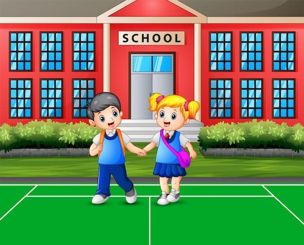Caricatura de un niño y una niña yendo a casa después de la escuela Vector Premium