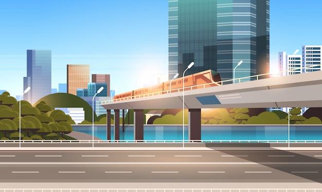 Carretera carretera ciudad calle con modernos rascacielos Vector Premium