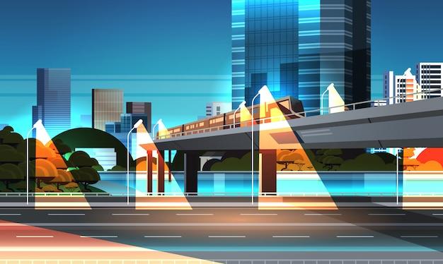 Carretera carretera noche ciudad calle con modernos rascacielos Vector Premium