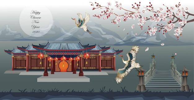 Casa china con pájaro grúa y hermosos ciruelos que cruzan el puente en la montaña Vector Premium