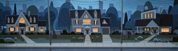 Casas vista nocturna suburbio de gran ciudad Vector Premium
