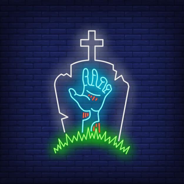 Cementerio con signo de neón de mano de lápida y zombie vector gratuito