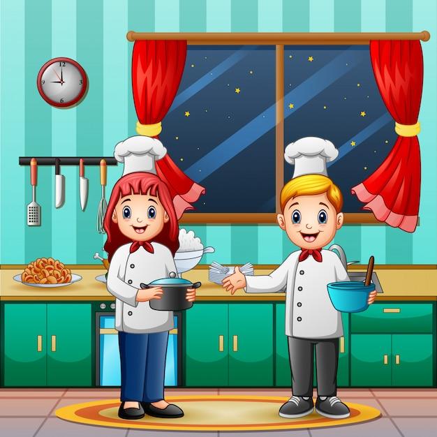 Chef hombre y mujer en la cocina Vector Premium