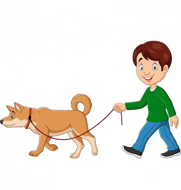 Chico lindo caminando con perro Vector Premium