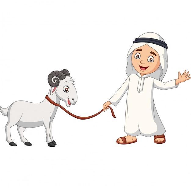 Chico musulmán árabe de dibujos animados con una cabra Vector Premium