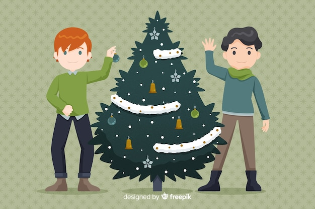 Chicos decorando el árbol de navidad vector gratuito