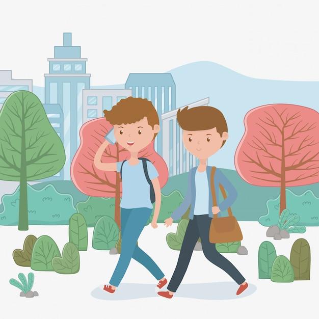 Chicos jóvenes caminando con teléfonos inteligentes en el parque vector gratuito