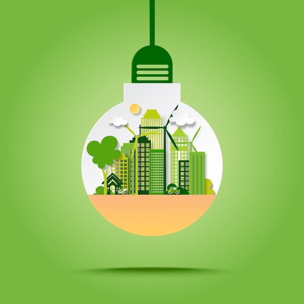 Ciudad ecológica verde con concepto de ahorro de energía y reciclaje en estilo de arte de papel de bombilla. Vector Premium