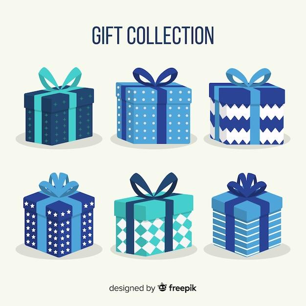Colección colorida de cajas de regalos de navidad en diseño plano vector gratuito