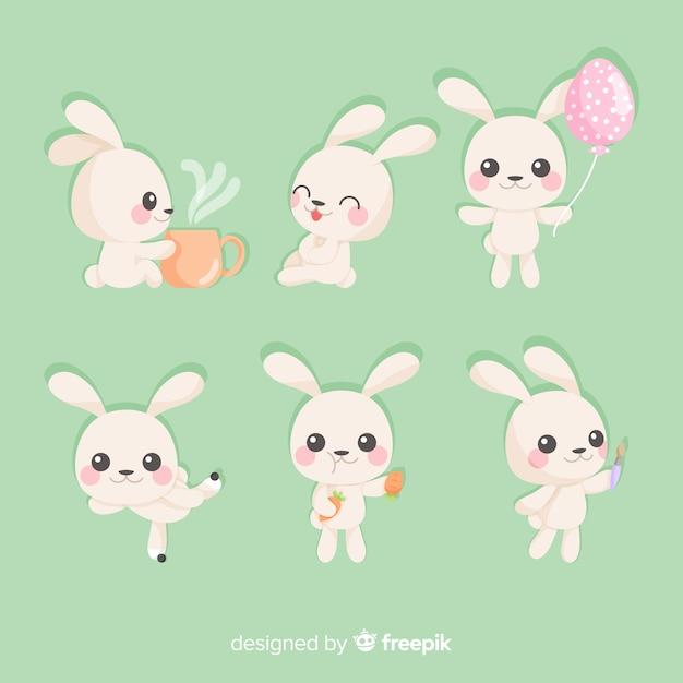 Colección de conejos de pascua en diseño plano Vector Premium