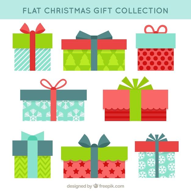 Colección de regalos navideños de colores en estilo plano ...