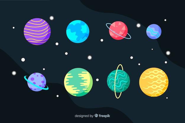 Colección de diseño plano de planetas y estrellas vector gratuito