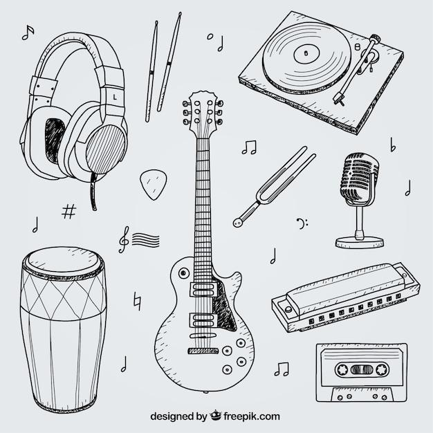 Colección de elementos dibujados a mano para un estudio de música vector gratuito