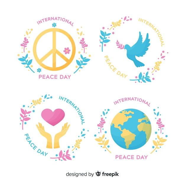 Colección de emblemas del día de la paz dibujadas a mano vector gratuito