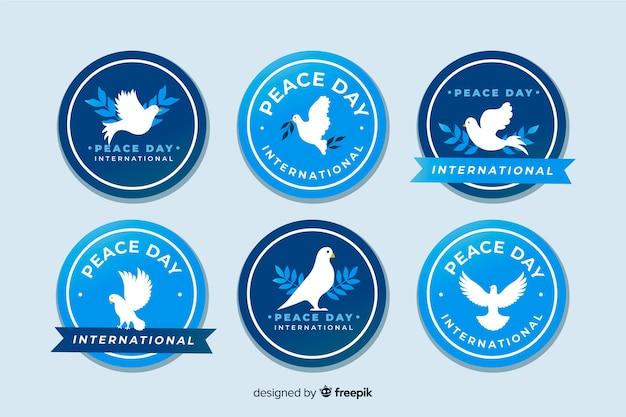 Colección de emblemas del día de la paz dibujado a mano vector gratuito