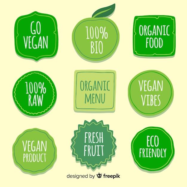 Colección de etiquetas de comida orgánica dibujadas a mano vector gratuito