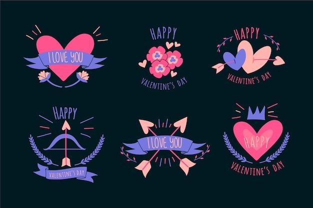 Colección de etiquetas y distintivos de san valentín con corazones y cintas vector gratuito