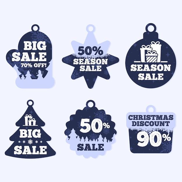 Colección de etiquetas navideñas en diseño plano vector gratuito