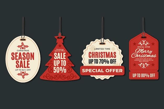 Colección de etiquetas de rebajas navideñas en diseño plano Vector Premium