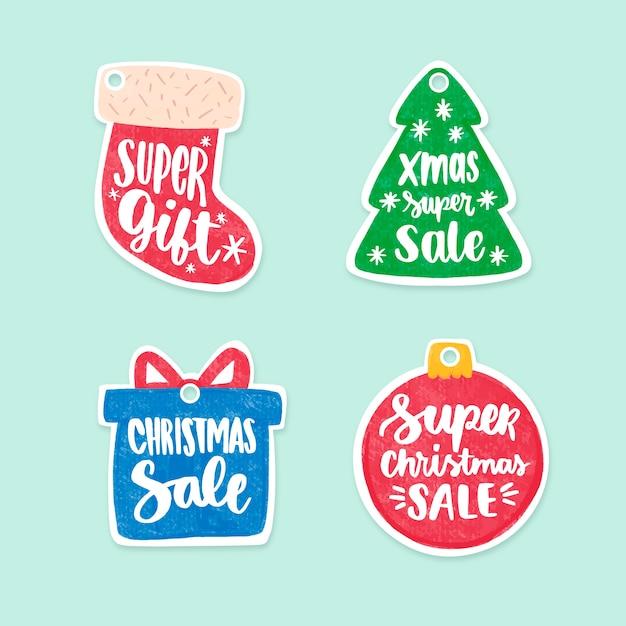 Colección de etiquetas de venta de navidad dibujadas a mano vector gratuito