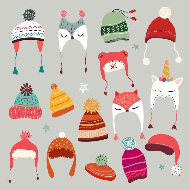 Colección de gorros de invierno con elementos de temporada dibujados a mano. Vector Premium
