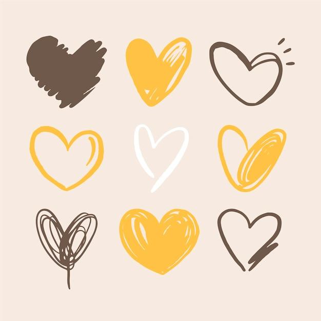Colección de ilustraciones de corazones dibujados a mano vector gratuito