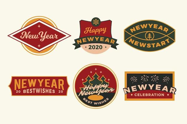 Colección de insignias de año nuevo 2020 dibujadas a mano vector gratuito