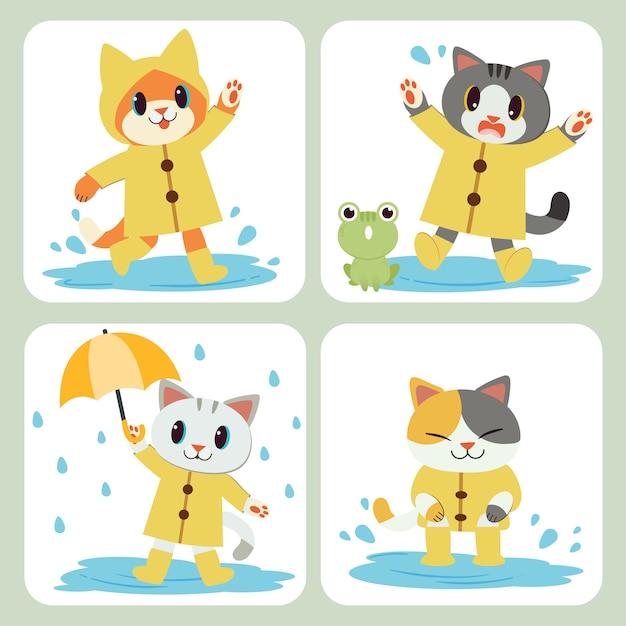 La colección de lindo gato usa el impermeable amarillo y el paraguas y las botas. Vector Premium