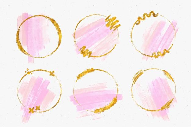 Colección de marcos dorados con trazos de pincel de acuarela vector gratuito