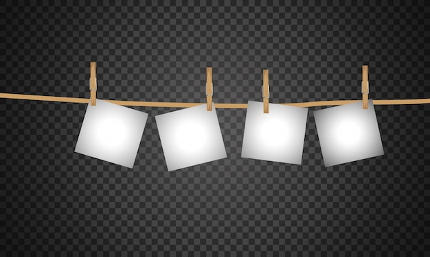 Colección de marcos de fotos en blanco colgando de pinzas para la ropa en una cuerda. Vector Premium