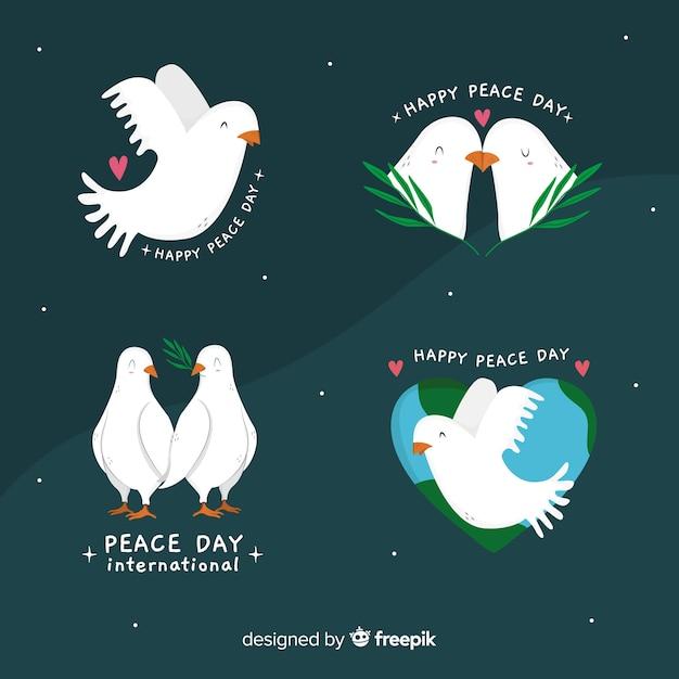 Colección de palomas dibujadas a mano del día de la paz vector gratuito