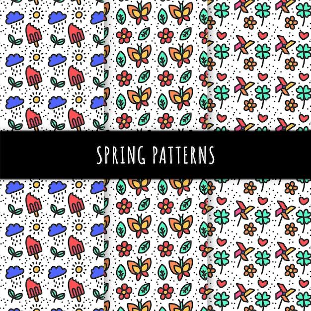 Colección de patrones de primavera dibujados a mano con mariposas y helados vector gratuito