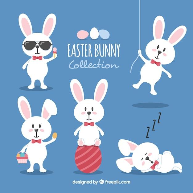 Colección plana de conejos de pascua vector gratuito