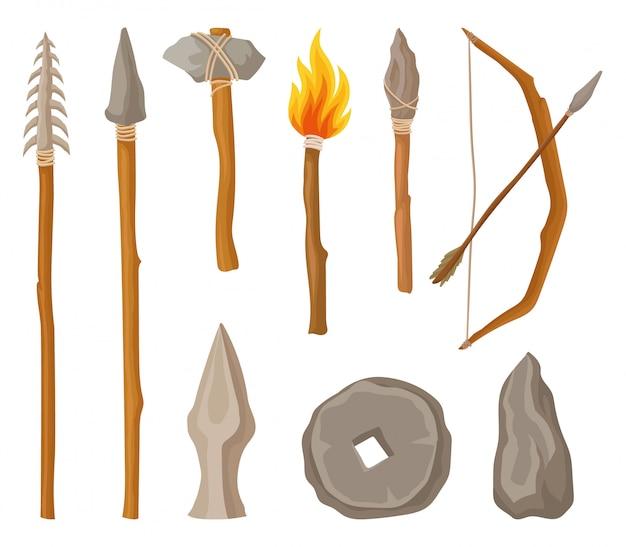 Colección de símbolos de la edad de piedra, herramientas y armas del hombre prehistórico ilustración sobre un fondo blanco Vector Premium