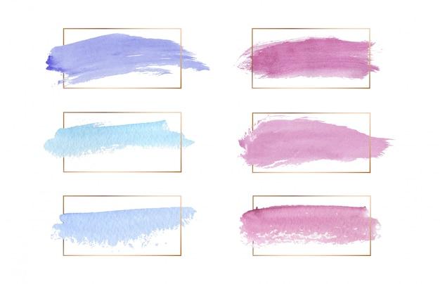 Los colores rosa, azul y morado trazo de pincel textura acuarela con marcos de líneas doradas. Vector Premium