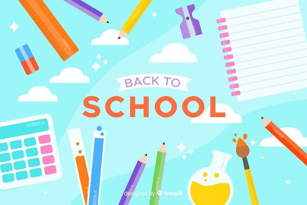 Composición de regreso a la escuela con diseño plano de fondo azul vector gratuito