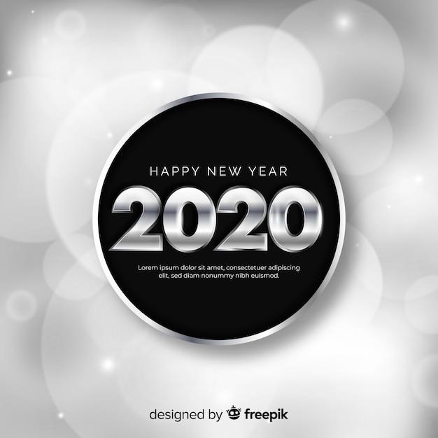 Concepto de año nuevo con diseño plateado vector gratuito