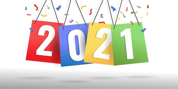 Concepto creativo de feliz año nuevo 2021 en papel de colores colgantes. vector gratuito