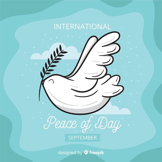 Concepto del día de la paz con paloma de diseño plano vector gratuito