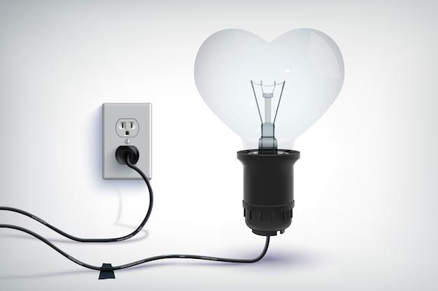 Concepto romántico realista de bombilla con cable realista en forma de corazón con enchufe aislado vector gratuito