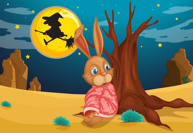 Un conejo al lado de un gran tronco de árbol vector gratuito