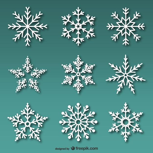 Conjunto de copos de nieve blancos vector gratuito
