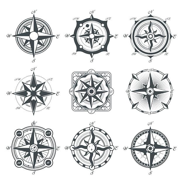 Conjunto de diferentes brújulas vintage. vector gratuito
