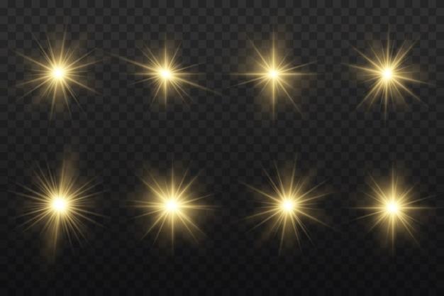 Conjunto de estrella estalló con brillo, estrella brillante resplandor, luz brillante amarilla estalló sobre un fondo transparente, rayos de sol amarillo, efecto de luz dorada, destello de sol con rayos. Vector Premium