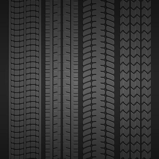Conjunto de impresiones de diferentes tipos de neumáticos sobre un fondo gris oscuro. ilustración vectorial vector gratuito