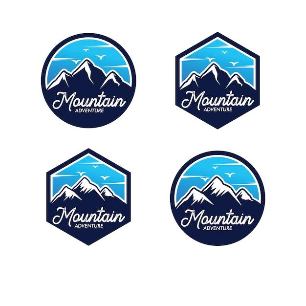 Conjunto de logotipo de aventura de montaña Vector Premium