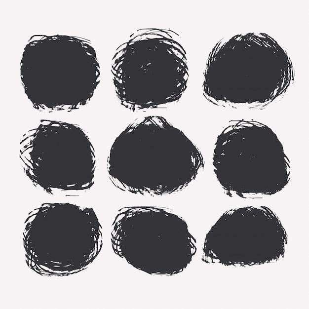 Conjunto de manchas circulares de grunge o pintura vector gratuito