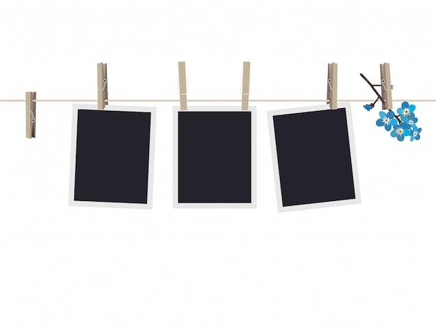 Conjunto de marcos de fotos en blanco colgando de pinzas para la ropa Vector Premium