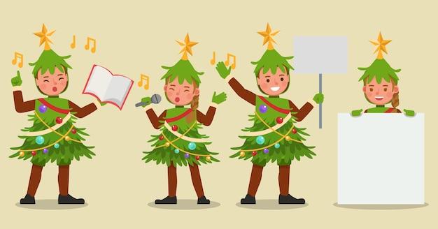 Conjunto de niños niño y niña con personaje de disfraces de árbol de navidad Vector Premium