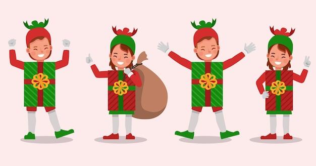 Conjunto de niños niño y niña con personaje de disfraces de caja de regalo de navidad Vector Premium